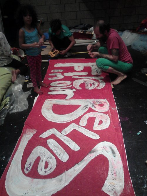 working on the FIRE banner at the Queer Planet build