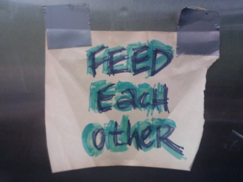 """feed each other"" on the fridge at Sylvia's Place"